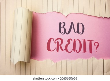 Writing note showing  Bad Credit Question. Business photo showcasing Low Credit Finance Economic Budget Asking Questionaire written on the pink background behind Tear Notebook Paper.