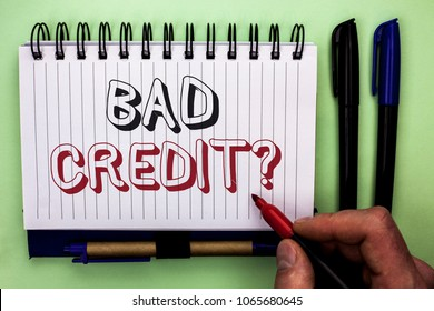 Writing note showing  Bad Credit Question. Business photo showcasing Low Credit Finance Economic Budget Asking Questionaire written by Man Holding Marker on Nootbook Book plain background Marker.