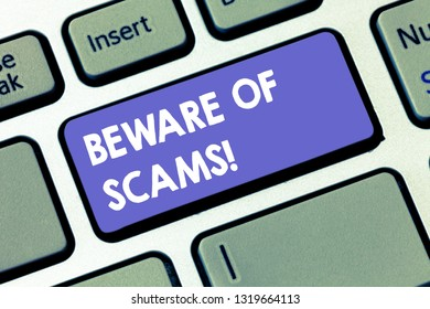 Writing note showing Beware Of Scams. Business photo showcasing Stay alert to avoid fraud caution be always safe security Keyboard key Intention to create computer message pressing keypad idea.