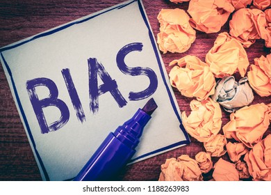 Writing note showing Bias. Business photo showcasing Prejudice in favor of and against one thing Considered to be Unfair