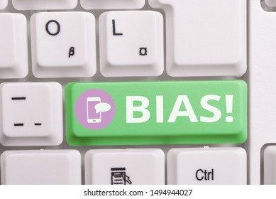 Writing note showing Bias. Business photo showcasing inclination or prejudice for or against one demonstrating group Keyboard with note paper on white background key copy space.
