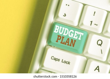 Writing note showing Budget Plan. Business photo showcasing financial schedule for a defined period of time usually year White pc keyboard with note paper above the white background.