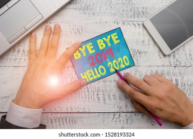 Writing note showing Bye Bye 2019 Hello 2020. Business photo showcasing Starting new year Motivational message 2019 is over.