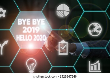 Writing note showing Bye Bye 2019 Hello 2020. Business photo showcasing Starting new year Motivational message 2019 is over Male human wear formal suit presenting using smart device.
