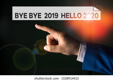 Writing note showing Bye Bye 2019 Hello 2020. Business photo showcasing Starting new year Motivational message 2019 is over Isolated hand pointing with finger. Business concept pointing finger.