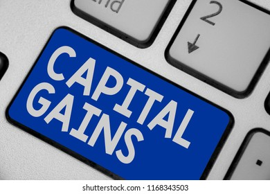 Writing note showing Capital Gains. Business photo showcasing Bonds Shares Stocks Profit Income Tax Investment Funds Keyboard blue key Intention computer computing reflection document.