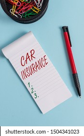Writing note showing Car Insurance. Business photo showcasing Accidents coverage Comprehensive Policy Motor Vehicle Guaranty Notebook and stationary with mouse above pastel backdrop.