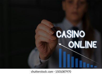 Writing note showing Casino Online. Business photo showcasing Computer Poker Game Gamble Royal Bet Lotto High Stakes Woman wear formal work suit presenting presentation using smart device.