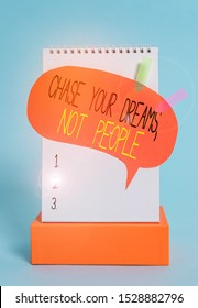 Writing note showing Chase Your Dreams Not People. Business photo showcasing Do not follow others chasing goals objectives Spiral notepad box speech bubble arrow banners cool colored background.