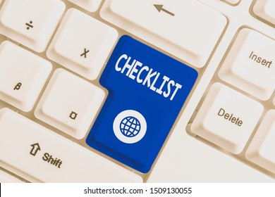 Writing note showing Checklist. Business photo showcasing List down of the detailed activity as guide of doing something White pc keyboard with note paper above the white background.