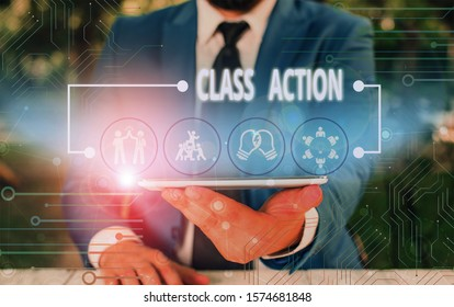 Writing note showing Class Action. Business photo showcasing lawsuit filed by small group acting on behalf of a large group Male wear formal work suit presenting presentation smart device.
