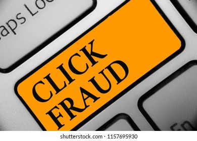 Writing note showing Click Fraud. Business photo showcasing practice of repeatedly clicking on advertisement hosted website Keyboard orange key Intention computer computing reflection document.