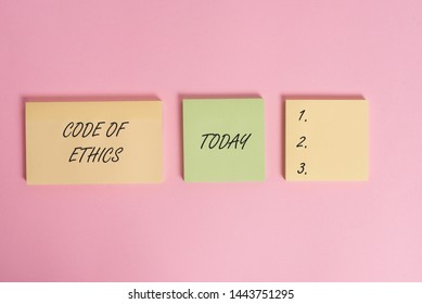Writing note showing Code Of Ethics. Business photo showcasing basic guide for professional conduct and imposes duties Close up front view three multicolor blank notepads colored background.