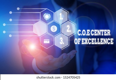 Writing note showing Coe Center Of Excellence. Business photo showcasing being alpha leader in your position Achieve Male wear formal suit presenting presentation smart device.