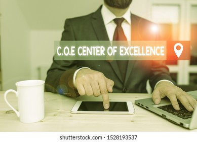 Writing note showing Coe Center Of Excellence. Business photo showcasing being alpha leader in your position Achieve.