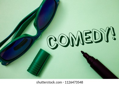 Writing note showing  Comedy Call. Business photo showcasing Fun Humor Satire Sitcom Hilarity Joking Entertainment Laughing Ideas messages white background open marker sunglasses communicate.