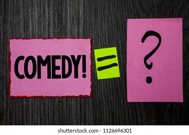 Writing note showing  Comedy Call. Business photo showcasing Fun Humor Satire Sitcom Hilarity Joking Entertainment Laughing Pink notes equal sign question mark wooden wood background inspiration.
