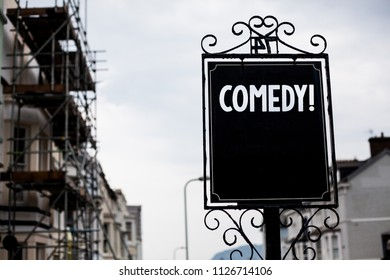 Writing note showing  Comedy Call. Business photo showcasing Fun Humor Satire Sitcom Hilarity Joking Entertainment Laughing Vintage black board sky old city ideas scaffolding landscapes antique.