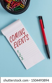 Writing note showing Coming Events. Business photo showcasing Happening soon Forthcoming Planned meet Upcoming In the Future Notebook and stationary with mouse above pastel backdrop.