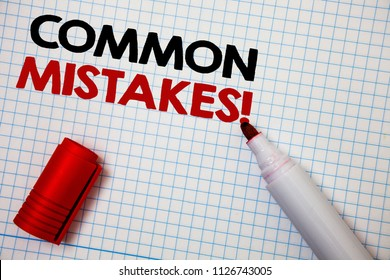 Writing note showing  Common Mistakes Motivational Call. Business photo showcasing lot of people do same action in wrong way Graph paper grey important thoughts idea information science math data.