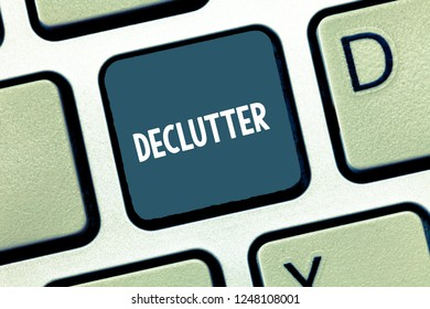 Writing note showing Declutter. Business photo showcasing remove unnecessary items from untidy or overcrowded place Keyboard Intention to create computer message keypad idea.