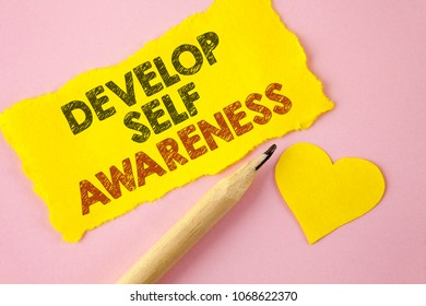 Writing note showing  Develop Self Awareness. Business photo showcasing What you think you become motivate and grow written Tear Yellow paper piece Pink background Heart next to it.