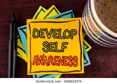Writing note showing  Develop Self Awareness. Business photo showcasing What you think you become motivate and grow written Sticky Note paper Wooden background Coffee Cup and Marker
