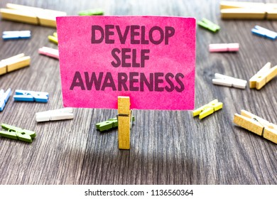 Writing note showing Develop Self Awareness. Business photo showcasing increase conscious knowledge of own character Multiple clips woody table small card clipped notice announcement.