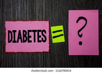 Writing note showing  Diabetes. Business photo showcasing Chronic disease associated to high levels of sugar glucose in blood Pink notes equal sign question mark wooden wood background inspiration.