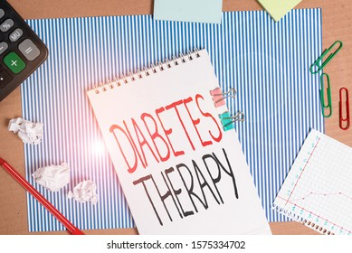 Writing note showing Diabetes Therapy. Business photo showcasing aim to achieve lower average blood glucose results Striped paperboard notebook cardboard office study supplies chart paper.