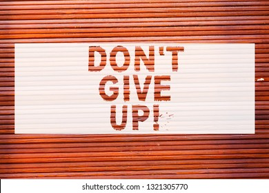 Writing note showing Don T Give Up. Business photo showcasing Keep trying until you succeed follow your dreams goals Brick Wall art like Graffiti motivational call written on the wall.