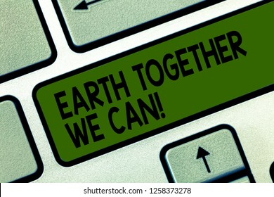 Writing note showing Earth Together We Can. Business photo showcasing Environment protection recycling reusing ecological Keyboard key Intention to create computer message pressing keypad idea.
