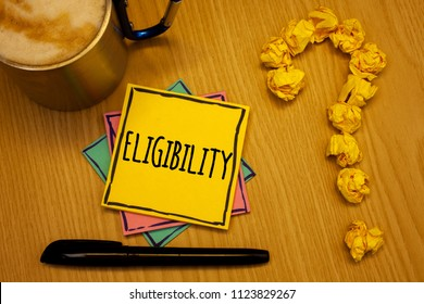 Writing note showing  Eligibility. Business photo showcasing State of having the right for doing or obtain something Proper Message wood table coffee cup question mark crumpled papers.