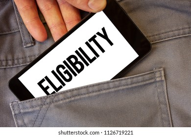 Writing note showing  Eligibility. Business photo showcasing State of having the right for doing or obtain something Proper Man holding cell phone white screen jean pocket messages application.