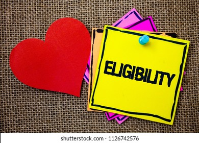 Writing note showing  Eligibility. Business photo showcasing State of having the right for doing or obtain something Proper Ideas messages paper papers red heart love message jute background.