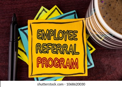 Writing note showing  Employee Referral Program. Business photo showcasing Recommend right jobseeker share vacant job post written on Sticky Note paper on Wooden background Coffee Cup and Marker