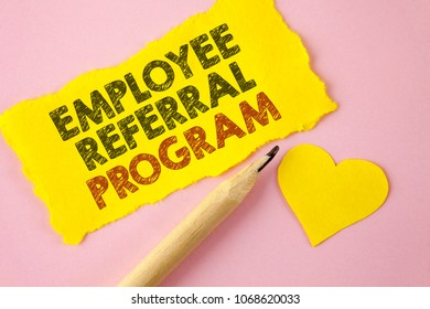Writing note showing  Employee Referral Program. Business photo showcasing Recommend right jobseeker share vacant job post written Tear Yellow paper piece Pink background Heart next to it.