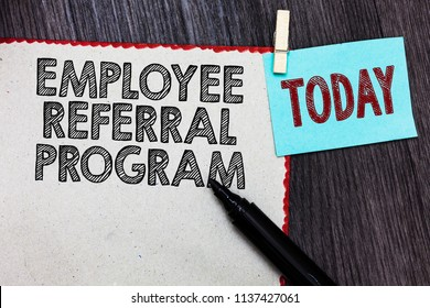 Writing note showing Employee Referral Program. Business photo showcasing employees recommend qualified friends relatives White page red borders marker clothespin reminder wooden background.
