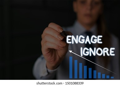 Writing note showing Engage Ignore. Business photo showcasing Silent Treatment Manipulative Punishment Sulking Shunning Woman wear formal work suit presenting presentation using smart device.