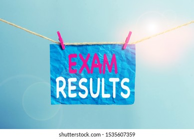 Writing note showing Exam Results. Business photo showcasing An outcome of a formal test that shows knowledge or ability Clothesline clothespin rectangle shaped paper reminder white wood desk.