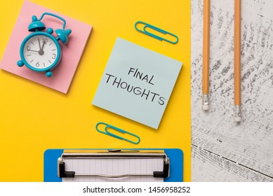 Writing note showing Final Thoughts. Business photo showcasing the conclusion or last few sentences within your conclusion Notepads paper sheet clipboard markers alarm clock wooden background.