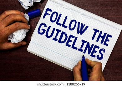 Writing note showing Follow The Guidelines. Business photo showcasing Manual of Style Follow a Specified Rule Accordingly Man holding marker notebook page crumpled paper several tries mistakes.