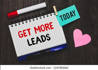 Writing note showing Get More Leads. Business photo showcasing Inbound Marketing Process of attracting prospective buyer Open notebook pin holding reminder marker heart wooden background.