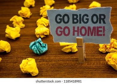 Writing note showing  Go Big Or Go Home Motivational Call. Business photo showcasing Mindset Ambitious Impulse Persistence Cardboard with letters wooden floor fuzzy yellow lumps green hunch.