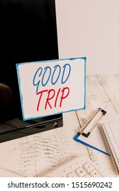 Writing note showing Good Trip. Business photo showcasing A journey or voyage,run by boat,train,bus,or any kind of vehicle Note paper taped to black computer screen near keyboard and stationary.