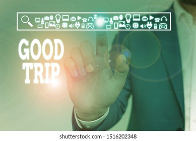 Writing note showing Good Trip. Business photo showcasing A journey or voyage,run by boat,train,bus,or any kind of vehicle Male wear formal work suit presenting presentation smart device.