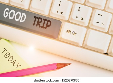 Writing note showing Good Trip. Business photo showcasing A journey or voyage,run by boat,train,bus,or any kind of vehicle White pc keyboard with note paper above the white background.