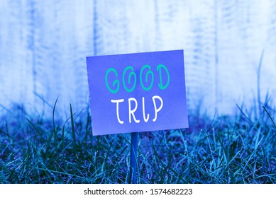 Writing note showing Good Trip. Business photo showcasing A journey or voyage,run by boat,train,bus,or any kind of vehicle Plain paper attached to stick and placed in the grassy land.