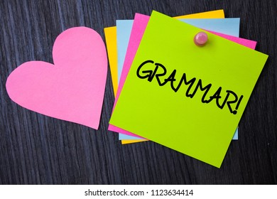 Writing note showing  Grammar Motivational Call. Business photo showcasing System and Structure of a Language Writing Rules Papers heart wood wooden background love lovely message ideas thoughts.