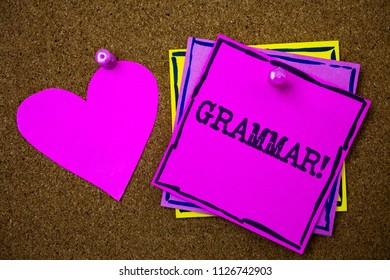 Writing note showing  Grammar Motivational Call. Business photo showcasing System and Structure of a Language Writing Rules Papers pink heart cork background ideas love lovely message to remember